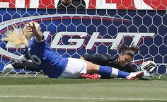 Goalkeeper Hope Solo #1 of the USA blocks the shot of Kaylyn Kyle (6) of Canada during the first half of the women's Olympic send-off soccer match June 30, 2012 at Rio Tinto Stadium in Sandy, Utah. The USA beat Canada 2-1.