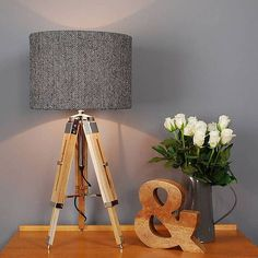 A high quality, wooden tripod table lamp base with a choice of Harris Tweed Herringbone shade.The Harris Tweed Harringbone is available in a range of colours, please see photos and option drop down box.The bases are finished in a natural wood so co-ordinate well with all colour schemes. Adjustable from each leg and at the neck so you can alter the height of the light. The Harris Tweed is woven by hand in the outer hebrides and each shade is finished with the famous Orb mark label. Please…