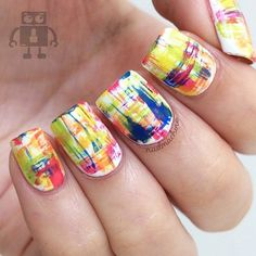 Watercolor inspired abstract nail art. Beautiful swabs of different colors on top of a plain white base coat.