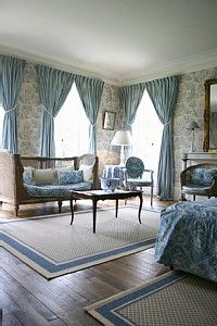 Toile wall paper. The room is nicely put together.