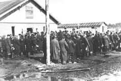 Salaspils, Latvia, Jews in the camp, waiting in line to receive food. Food was watery soup and moldy piece of bread with little nutrition. They lived on less then 600 calories a day
