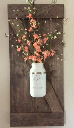 Mason jar hanging on a mini barn wooden door.