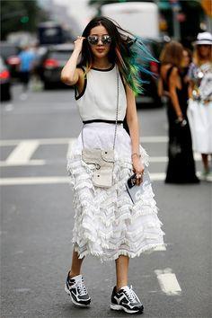 Irene in a Fringe prairie skirt by Chanel. #IreneKim #NYFW