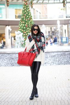 Wearing an oversized tartan scarf with knitwear will always go down a treat! Rachel Parcell demoes the look; choosing to wear it with tight leather leggings and a gorgeous crimson Celine bag. Sweater: Tory Burch, Leggings/Scarf: ASOS, Boots: Jeffrey Campbell, Bag: Celine.