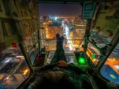 THE CRANE OPERATOR'S VIEW   Photograph by MildlyReactive on deivantART   In this fantastic shot by MildlyReactive we see what a crane operator's view would be like at night. The photographer is not actually a crane operator, he's an Urban Explorer or 'Rooftopper' who likes to scale buildings and other objects of significant height