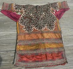 Superb Old Sind Wedding Choli This is a spectacular heavily embroidered dress or choli from the Sind region, probably made and used by a bride in her wedding. The choli is fully embroidered on the entire front and back, making it a very heavy textile with som much stitching.