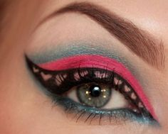 Blue and pink eye makeup with winged liner and cute pink hearts