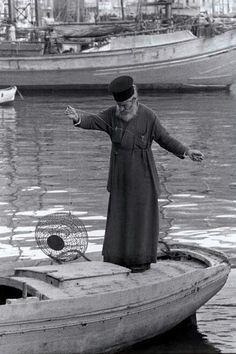 1964 Priest fishing Photo by Constantine Manos. Zorba The Greek, Greek Culture, Photographer Portfolio, Magnum Photos, Crete, Greek Islands, Vintage Pictures, Priest, Belle Photo