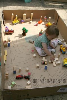 A great, inexpensive idea for little ones: small world play with a large cardboard box! Love this set up from The Imagination Tree!