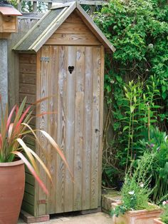 Tool Shed is Both Decorative and Functional - would love this painted