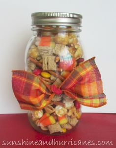 Scarecrow Snack Mix- This simple and festive snack is perfect for any kind of fall or Halloween party snack! Only a few easy ingredients and so delcious. No really it's totally addictive!!!  sunshineandhurricanes.com