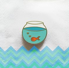 Pin Club creates a new limited edition pin every month! This lonely goldfish is looking for a new home! Hard enamel with rubber clutch  22 x 20mm