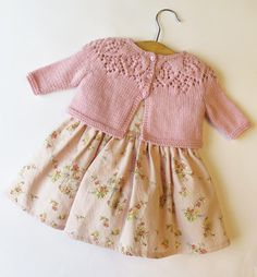 Knitting Pattern for a cute baby and toddler cardigan with lace on the yoke.