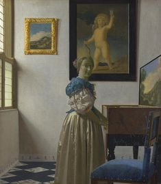 Johannes Vermeer - A Young Woman standing at a Virginal, 1670 at the National Gallery London England Johannes Vermeer, Delft, National Gallery, National Portrait Gallery, Rembrandt, Renaissance, Vermeer Paintings, List Of Paintings, Art Paintings