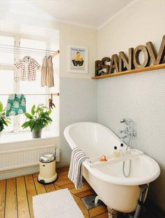 5 Ideas For Kids' Bathrooms | Handmade Charlotte Love the clothesline in the window