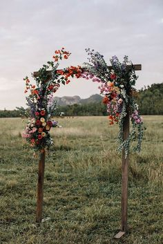 Simple wooden floral arch for your wedding ceremony