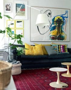 This looks like our black leather couch. I love the way the art is hung and the funky pillows makes it look more modern.