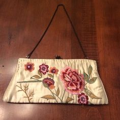 Small satin clutch with embroidery. Really cute clutch - barely used. Bags Clutches & Wristlets