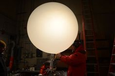 The weather balloon after it is inflated. Rolf ties the bottom closed. Weather Balloon, Design Festival, Seattle, Ties, Balloons, Lighting, Image, Neck Ties, Tie