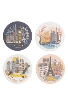 Travel the world without leaving home with this set of cardboard coasters by Rifle Paper Co. featuring vintage-inspired illustrations of four world-famous cities.