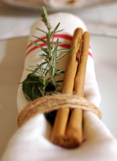 Cinnamon stick and a sprig of rosemary