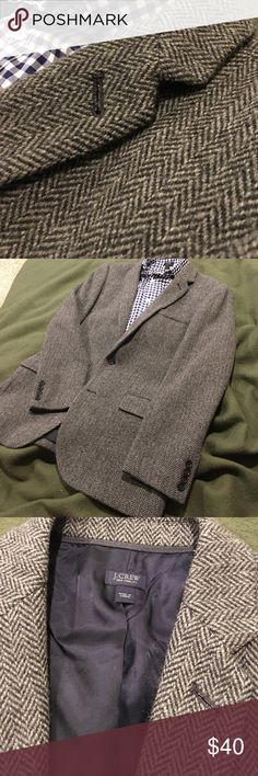 JCrew Ludlow Blazer in herringbone wool tweed Charcoal color.  85%wool/15%nylon.  Super soft and comfy. Very warm. Center Back vent.  Worn but no visible wear on the outside.  Only visible wear is in inside armpit area and a slightly loose button that may need reattaching at some point.  Out pockets have never been opened. No signs of pilling in the wool. J. Crew Suits & Blazers Sport Coats & Blazers
