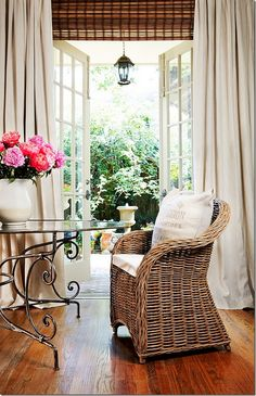 LOVE the wicker, detailed iron table, pink peonies, and EVERYTHING ELSE~! French door layering in home of Joni Webb, Cote de Texas Drapes and rolled up blinds Sweet Home, Bamboo Blinds, Woven Blinds, Matchstick Blinds, House Blinds, Banquette, Family Room, Living Spaces, Decoration