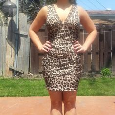 V-Neck Sleeveless Cheetah Print Dress Ruched dress all around 96% Polyester 4% Spandex Size Medium Dresses
