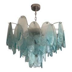 This is a Murano chandelier composed of turquoise blown glass (upside down) hearts. Turquoise Chandelier, Murano Chandelier, Modern Chandelier, Ceiling Pendant, Ceiling Lamp, Ceiling Lights, Chandeliers, Art Graphique, Shop Lighting