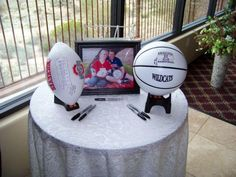 Have guests sign football or basketball at welcome table for a cute wedding keepsake....LOVE this idea, too bad it doesnt go with my theme :(  lol
