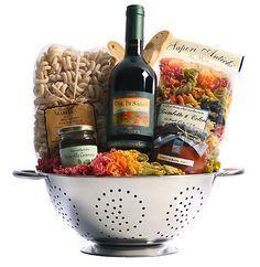 Great Gift Basket idea: Italian wine, colander, unique pasta, tomato sauce, pesto, and biscotti. Maybe a wooden spoon or two? #italianwine