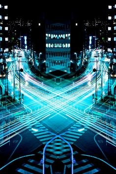 """""""Graffiti of Speed / Mirror Symmetry"""" is a project the Japanese photographer Shinichi Higashi who captured the stunning pictures of speedy cityscape of Tokyo by combining symmetrical and long exposure techniques."""