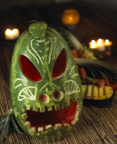 Tiki Mask Table Decoration - I might have to do this with a pumpkin for Halloween too! (National Watermelon Promotion Board - has GREAT ideas for watermelon carving & serving) Aloha Party, Hawaiian Luau Party, Tiki Party, Tropical Party, Hawaiian Theme, Beach Party, Hawaiian Tiki, Watermelon Art, Watermelon Carving