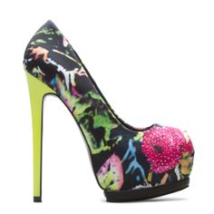 This bold statement platform features a sleek peep-toe and neon counter heel for vivid contrast