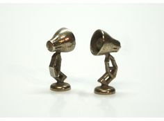 Cufflinks in the style of Luxo Jr, Pixar's mascot.  Custom printed at Shapeways, many finishes and metals available.