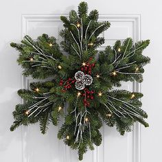 Give a gift as beautiful as fresh snow on Christmas morning. This stunning snowflake wreath is handcrafted with fresh, fragrant Noble Fir and decorated with painted pinecones, red faux berries, and… Decoration Christmas, Noel Christmas, Rustic Christmas, Xmas Decorations, Christmas Ornaments, Holiday Decor, Christmas Morning, Christmas Ideas, Christmas Inspiration