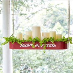 The cutest idea for a porch accent, using foliage, candles, etc.!