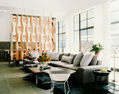 Neutral living room with groovy room divider