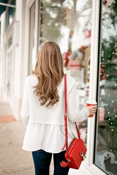 When it came to infusing a little more Christmas cheer into this classic white blouse and jeans combination, all it took was a few pops of that signature color to really start making things merry and bright!   holiday outfit ideas   outfit ideas for the holidays   winter fashion ideas   winter style tips   styling for winter   cold weather fashion    a lonestar state of southern