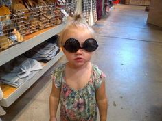 Lux out shopping with Gemma and Lou! is she wearing them upside down? hipster like uncle Harry