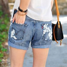 A bohemian summer staple! Make your own lace embroidered cut off jean shorts with this easy DIY! Those are the cutest!