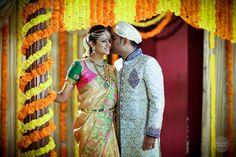 South Indian bride. Kanchipuram silk sari with contrast blouse. Braid with fresh flowers.Temple jewelry. Tamil bride. Telugu bride. Kannada bride. Malayalee bride. Hindu bride.