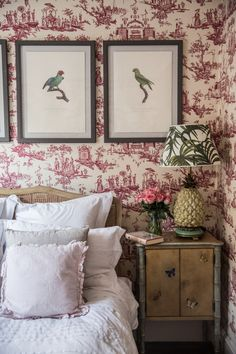 The bird prints above bed + Pineapple lamp + Wallpaper French toile