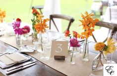 Farm Table Centerpieces of Mixed Flowers with Kraft Table Numbers | Photo by Diana Lott | Charleston Wedding by Engaging Events