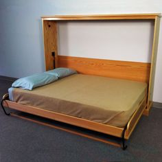 Murphy Bed -- One tug is all it takes, and the bed folds out smoothly and silently on state-of-the-art gas pistons.
