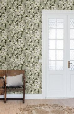 """The wallpaper """"White Lily"""" from Mr Perswall.  --""""There's something special about a chic lily, and they come in countless varieties. This lily is elegant yet a bit more shy than the really big ones."""" —Designer Helene Ekblom"""