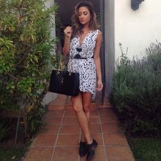 Shay's style is unbelievable! We're so loving her flowy dress and killer oxfords!
