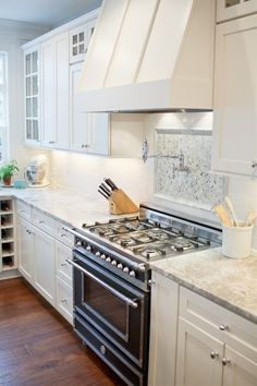 white kitchen with Vermont white granite, white shaker cabinets and Bertazzoni Heritage Collection Range. white kitchen with Vermont white granite, white shaker cabinets and Bertazzoni Heritage Collection Range. White Shaker Cabinets, White Kitchen Cabinets, Kitchen Redo, New Kitchen, Kitchen Remodel, Kitchen Dining, Kitchen White, Granite Kitchen, Kitchen Ideas