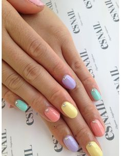 18 Easter Manicures to Complete Your Holiday Look | Beauty High | Playful but still elegant, this manicure is understated glam with a single sparkle to adorn each pastel polished nail.