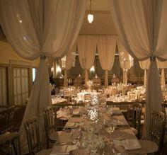 Photographer: Gerber Scarpelli; Classic white drape indoor wedding reception;